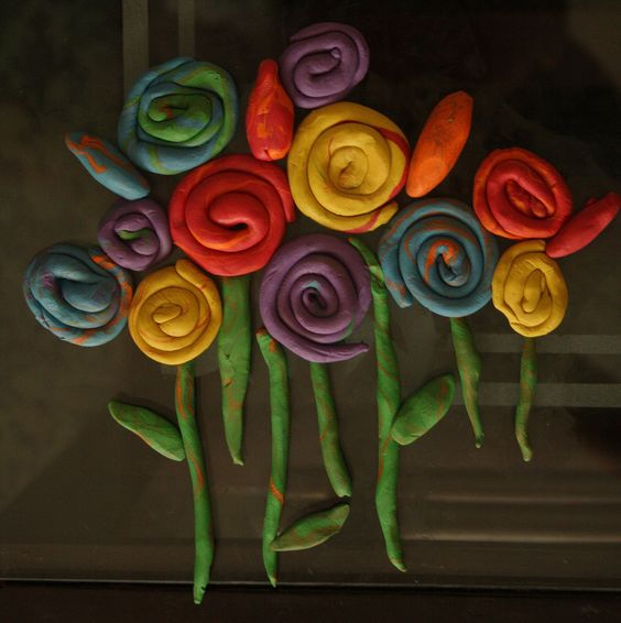 http://mumpaintslives.blogspot.com/2011/04/clay-flowers.html